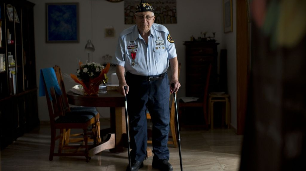 In this Tuesday, May 19, 2015 photo, U.S. Jewish World War II veteran Dan Nadel, who earned five battle stars leading combat engineer troops in the Battle of the Bulge and in the liberation of France, poses for a photo at his home in Jerusalem. (AP Photo/Oded Balilty)