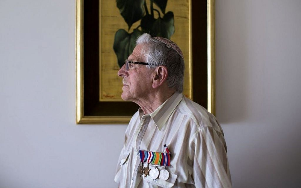 British Jewish World War II veteran Norman Cohen, who landed on the beaches of Normandy on D-Day with the British 2nd Army as a radio operator under the command of General Miles Dempsey, poses for a photo at his home in Jerusalem, May 2015. (AP Photo/Oded Balilty)