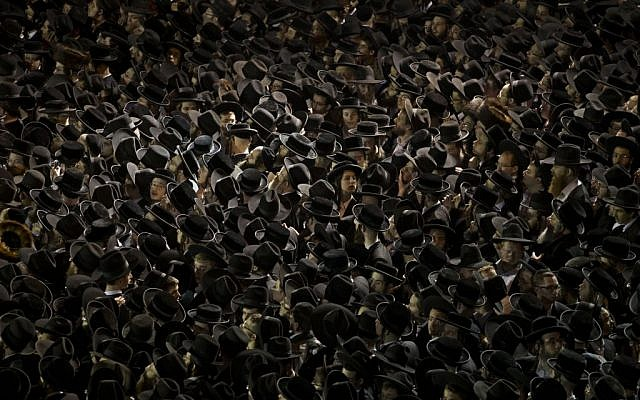 Thousands of ultra-Orthodox Jews gather near an Israeli Defense Forces recruitment center during a protest against military conscription, Jerusalem, May 16, 2013. (photo credit: AP/Bernat Armangue, File)
