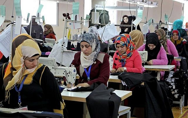 In this Wednesday, May 20, 2015 photo, Jordanian women sew jeans for the U.S. market in a garment factory in the village of Kitteh in northern Jordan. However, for millions of young people in the Middle East and North Africa unemployment has only worsened in the post-Arab Spring turmoil. (AP Photo credit: AP/Raad Adayleh)