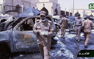File: In this still image taken from video provided by Saudi TV, burnt out cars are seen as investigators collect evidence, in the aftermath of a suicide bomb outside the the Imam Hussein mosque in the port city of Dammam, Saudi Arabia, Friday, May 29, 2015. (Saudi Television via AP)