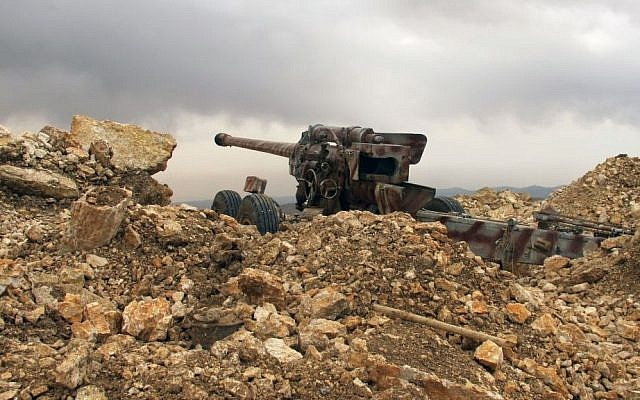 A Hezbollah cannon directed toward Syria in a military position for the group in the fields of the Lebanese border village of Brital, Lebanon, May 9, 2015. (photo credit: AP/Bassem Mroue)