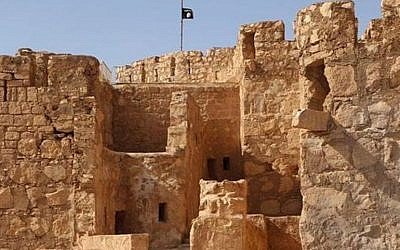 The Islamic State flag raised on top of Palmyra castle, May 22, 2015. (The website of Islamic State fighters via AP)