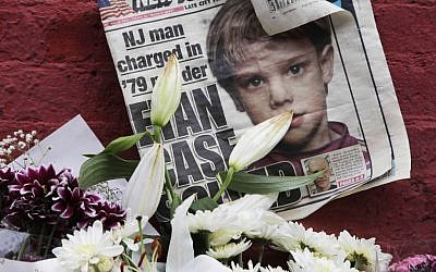 This May 28, 2012 file photo shows a newspaper with a photograph of Etan Patz at a makeshift memorial in the SoHo neighborhood of New York where Patz lived before his disappearance on May 25, 1979.  (AP/Mark Lennihan)