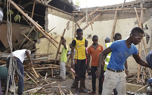 Rescue workers gather at the site of an explosion in Maiduguri, Nigeria, May 30, 2015. (AP/Jossy Ola)