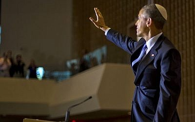 President Barack Obama, wearing a traditional Jewish yarmulke, waves after speaking at Adas Israel Congregation in Washington, Friday May 22, 2015. (AP Photo/Pablo Martinez Monsivais)