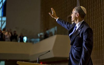 President Barack Obama, wearing a traditional Jewish yarmulke, waves, after speaking at Adas Israel Congregation in Washington, May 22, 2015. (AP Photo/Pablo Martinez Monsivais)