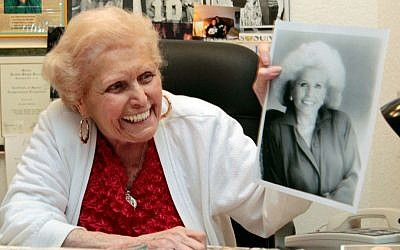 Jean Nidetch, founder of Weight Watchers, holds up a photo of herself at her home in Parkland, Fla. in 2011. (AP Photo/Alan Diaz, File)
