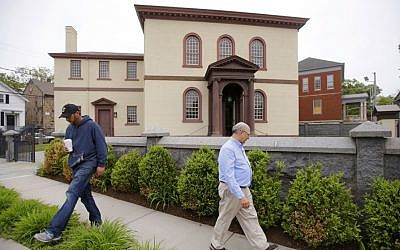 In this Thursday, May 28, 2015 photo, employees Chuck Flippo, right, and Asa Montgomery walk through Patriots Park at the Touro Synagogue, the nation's oldest, in Newport, Rhode Island. (AP/Stephan Savoia)