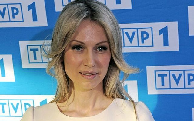 In this May 5, 2015 photo Magdalena Ogorek, the left wing candidate in a Sunday presidential election, poses for a photo prior to a televised debate in Warsaw, Poland. (AP Photo/Alik Keplicz)