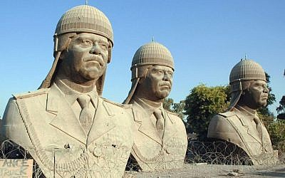 Thirty-foot tall bronze statues of the late dictator Saddam Hussein in Baghdad. The sculptures once sat atop towers in the Iraqi palace but were removed following the overthrow of the Baath regime. (Photo credit: Wikimedia commons)