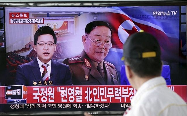 A man watches a TV news program reporting that North Korean People's Armed Forces Minister Hyon Yong Chol was killed by anti-aircraft gunfire, at Seoul Railway Station in Seoul, South Korea, Wednesday, May 13, 2015.  (Photo credit: Lee Jin-man/AP)