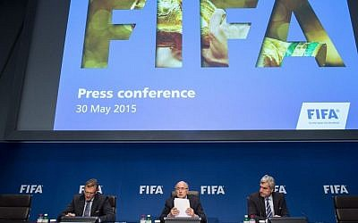 FIFA President Sepp Blatter, center, speaks next to Jerome Valcke, FIFA Secretary General, left, and Walter De Gregorio, Director Communications and Public Affairs, right, during a news conference following the FIFA Executive Committee meeting in Zurich, Switzerland, on Saturday, May 30, 2015. (Ennio Leanza/Keystone via AP)