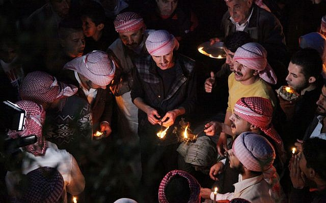 In this Tuesday, April 15, 2015 photo, Yazidis gather at the holy shrine of Lalish, 57 kilometers  north of Mosul, Iraq, as thousands gather to mark the New Year on April 15, 2015. (photo credit: AP/Seivan M. Salim)