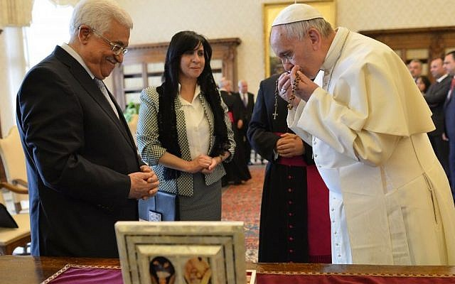 Pope Francis exchanges gifts with Palestinian leader Mahmoud Abbas during an audience at the Vatican Saturday, May 16, 2015. (Alberto Pizzoli/Pool Photo via AP)