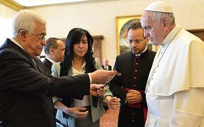 Pope Francis exchanges gifts with Palestinian Authority President Mahmoud Abbas during an audience at the Vatican Saturday, May 16, 2015.(Alberto Pizzoli/Pool Photo via AP)
