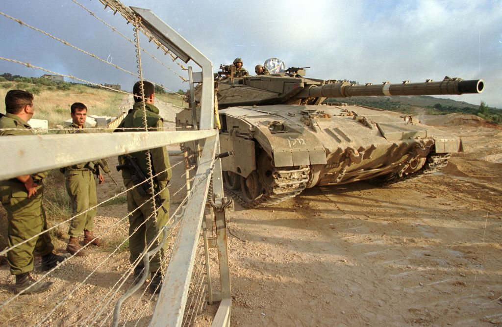 Israeli troops open the gates on the northern border for a tank during the IDF's 2000 withdrawal from Lebanon. (Photo by Flash90)
