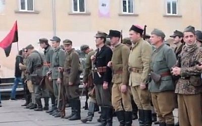 Far-right activists march in Lviv, Ukraine, wearing the uniform of the 14th Waffen Grenadier Division of the SS, an elite Nazi unite with many ethnic Ukrainians also known as the 1st Galician. in 2012. (Screen capture; YouTube)