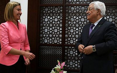 European Union foreign policy chief Federica Mogherini (L) stands next to Palestinian Authority President Mahmoud Abbas following a meeting at his headquarters in the West Bank city of Ramallah, on May 20, 2015 (AFP/ABBAS MOMANI)