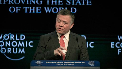 King Abdullah II of Jordan addresses the audience during the opening session of the World Economic Forum at the King Hussein convention center, Southern Shuneh, Jordan, Friday, May 22, 2015 (AP/Nasser Nasser)