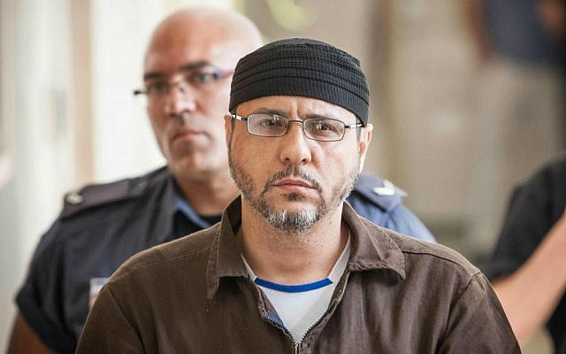 Abdullah Barghouti is taken to Jerusalem Magistrate's Court to testify as part of a US civil lawsuit against the Palestinian leadership, on June 20, 2012. (Noam Moskowitz/Flash90)