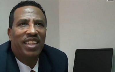 Adisu Massala in his office in Addis Ababa last week (screen capture: Channel 2)