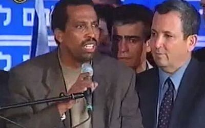 Adisu Masallah delivers a speech alongside Ehud Barak after losing his Knesset seat in 1999 (screen capture: YouTube)