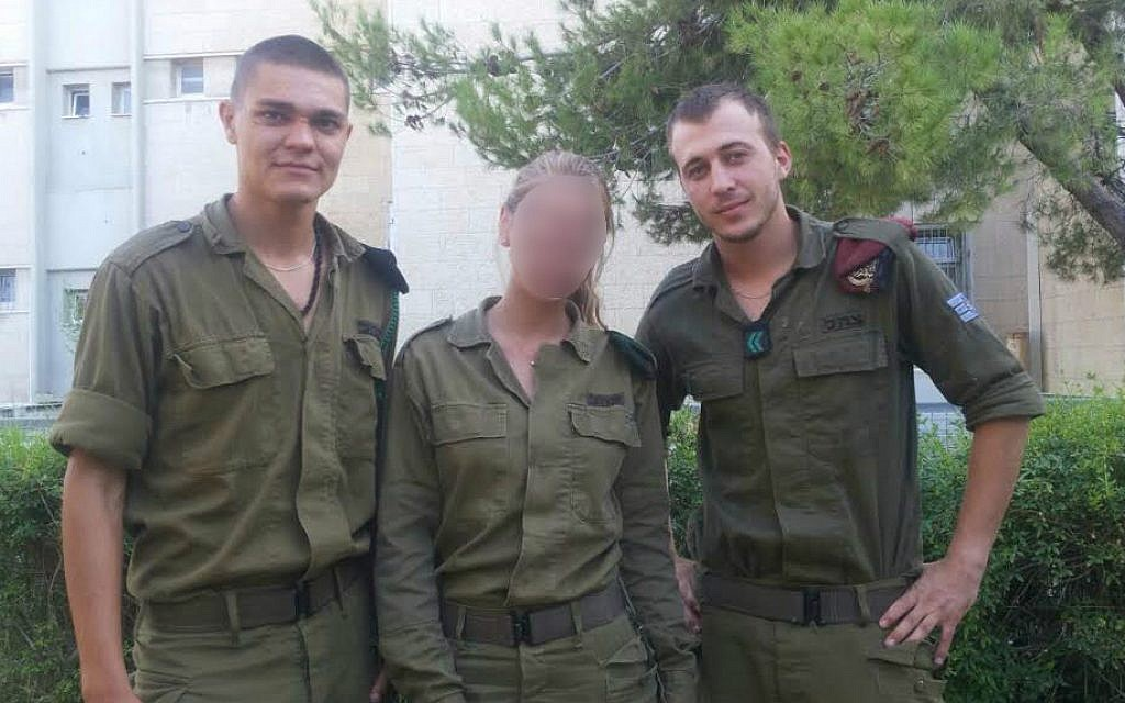 Then-First Sergeant Alex Asyanov, a paratrooper, right; Cpl. Katya, an NCO in military intelligence, who was not cleared to use her full name or show her face; and Sgt. Igor Havkin, a company sergeant in the Ordnance Corps' Basic Training (Netta  Asner/ IDF Spokesperson's Unit)