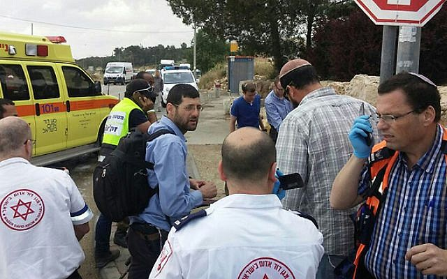 MDA paramedics respond to a suspected terrorist car-ramming attack outside of the West Bank settlement of Alon Shvut on May 14, 2015. (Courtesy Gush Etzion local council)