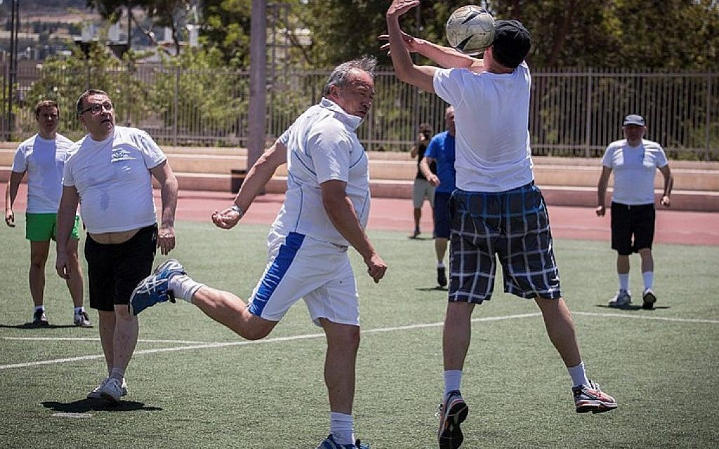Israeli Beytenu party leader, Avigdor Liberman, and his party members play soccer in Jerusalem against a team of the Russian Jewish Congress members, marking the victory day on Nazi Germany, 70 years ago. May 7, 2015. (Photo credit : Hadas Parush/Flash90)