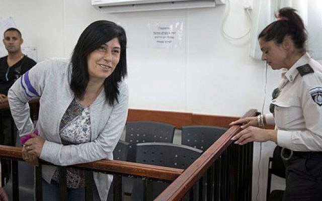 In this Thursday, May 21, 2015 file photo, Palestinian Parliament member Khalida Jarrar of the Popular Front for the Liberation of Palestine attends a court session charged with inciting violence, at the Israeli Ofer military base near the West Bank city of Ramallah (AP/Majdi Mohammed, File)