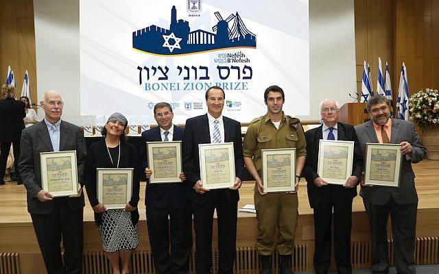 (L to R) Nefesh B'Nefesh 2015 Bonei Zion Prize recipients: Professor Charles Sprung; Chana Reifman Zweiter; Rabbi Dr. Seth Farber; Tal Brody; Staff Sgt. Asaf Stein, PhD; Asher Weill; and Jon Medved (Photo credit: Sasson Tiram)