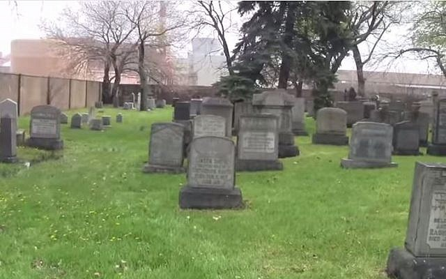 Beth Olem Jewish Cemetery located within the grounds of the General Motors vehicle manufacturing plant, Hamtramck, Detroit. (screen capture: YouTube/Bill Meyer)