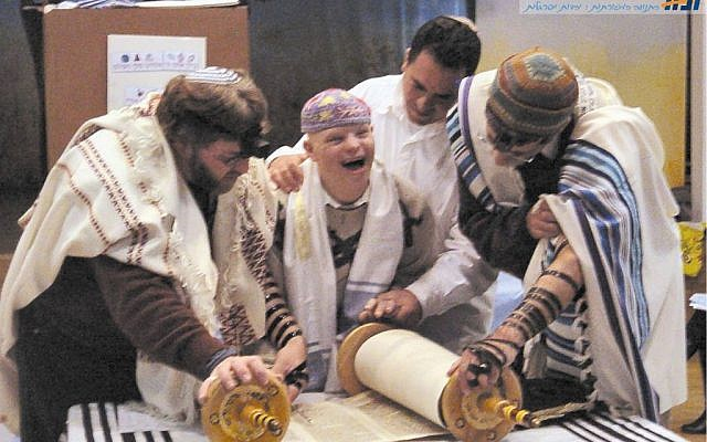 Illustrative photo: Disabled child reading from the Torah with the Masorti movement in Israel. (via Facebook)