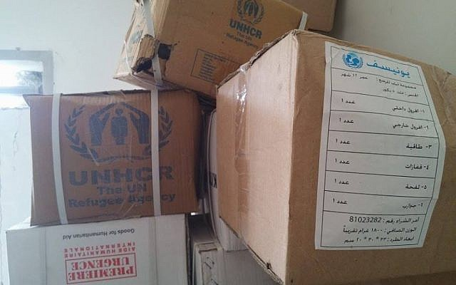 A photo published on the website of the Syrian National Coalition shows boxes of UN and Red Cross food parcels and relief aid found in a Syrian army base on Tuesday, May 19, 2015. According to the coalition, the Syrian army steals relief aid intended for the civilian population. (Courtesy Syrian National Coalition)