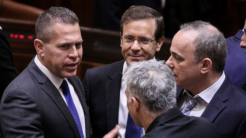 From left to right: Gilad Erdan (Likud), Isaac Hertzog (Zionist Union), Yuval Steinitz (Likud) and Yair Lapid (seen from the back) at the Knesset during the presentation of the new government, on May 14, 2015. (Photo credit: Isaac Harari/Knesset Spokesperson)