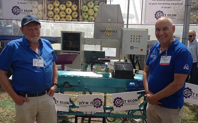 Professor Zeev Schmilovitch (L) and Eshet Eilon CEO Menashe Tamir with the company's NIR technology date sorting machine (Photo credit: Courtesy)