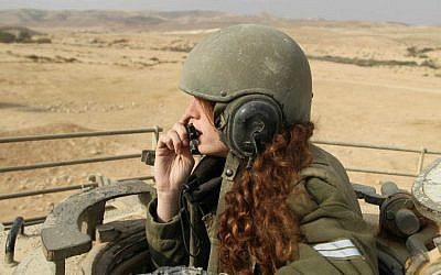 Illustrative image of a female IDF tank instructor during an exercise on January 1, 2013. (Cpl. Zev Marmorstein/IDF Spokesperson's Unit)