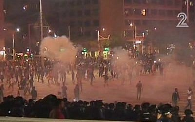 Tear gas in Rabin Square in Tel Aviv as a rally turned violent on May 3, 2015. (Screen capture: Channel 2)