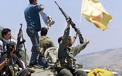 Hezbollah fighters celebrating on the day the IDF left South Lebanon, May 24, 2000. (AP: Enric Marti)
