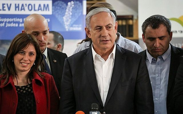 """File: Likud member Tzipi Hotovely (L) next to Prime Minister Benjamin Netanyahu and Zeev Elkin (R ), during a tour of the """"Lev HaOlam"""" (Heart of the World) organization, in Jerusalem on February 3, 2015. Hotovely was appointed deputy foreign minister by Netanyahu on Thursday, May 14 2015. Netanyahu did not appoint a foreign minister during the swearing-in of his new government. (Photo credit: Hadas Parush/Flash90)"""