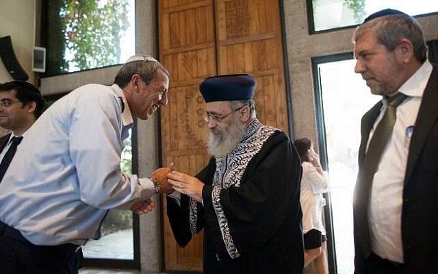 An illustrative photo of then IDF Chief Rabbi Brig. Gen. Rafi Peretz, left, with Sephardi Chief Rabbi Yitzhak Yosef on October 31, 2013 (Yonatan Sindel/ Flash 90)
