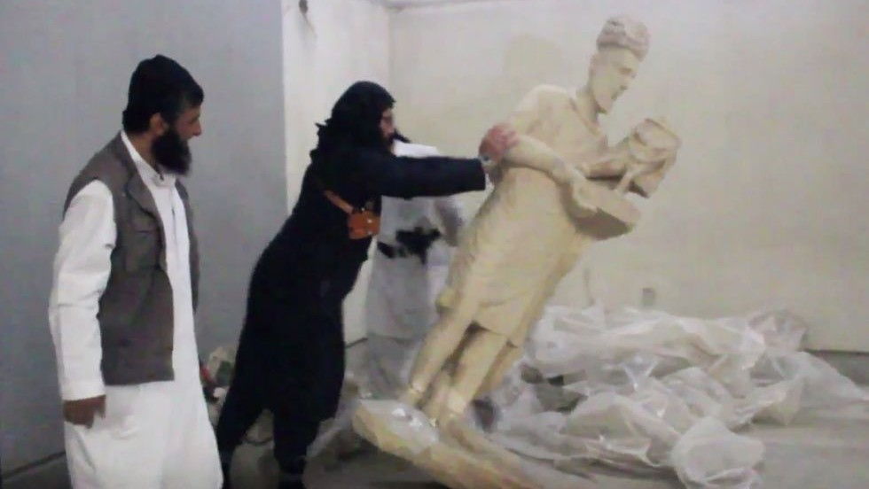 Illustrative: In this image made from video posted on a social media account affiliated with the Islamic State group on Thursday, February 26, 2015, a militant topples an ancient artifact in the Ninevah Museum in Mosul, Iraq. (Photo credit: AP via militant social media account, File)