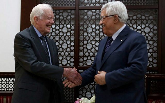 Palestinian Authority President Mahmud Abbas shakes hands with former US president Jimmy Carter during their meeting on May 2, 2015 in the West Bank city of Ramallah. (AFP/Pool/Abbas Momani)