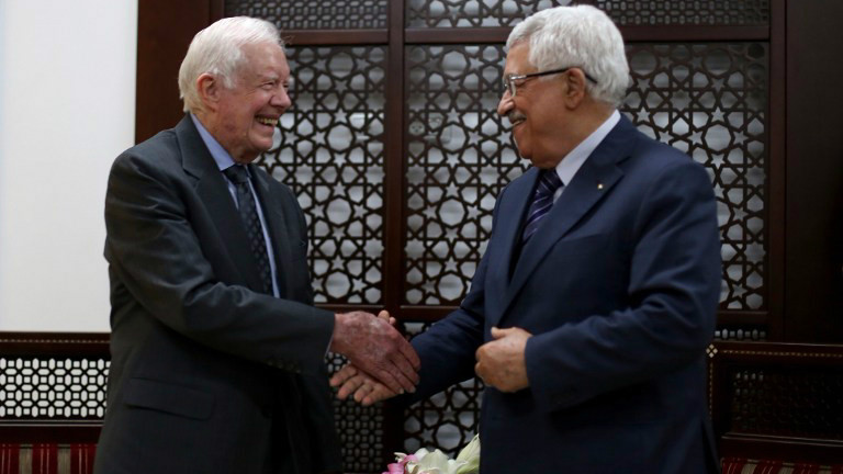 Palestinian leader Mahmud Abbas (R) shakes hands with Former US president Jimmy Carter during their meeting on May 2, 2015 in the West Bank city of Ramallah. (photo credit: AFP/Pool/Abbas Momani)