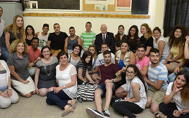 President Reuven Rivlin (back row, center) with pupils and teachers and the Givat Gonen School in Jerusalem (Mark Neiman/GPO)