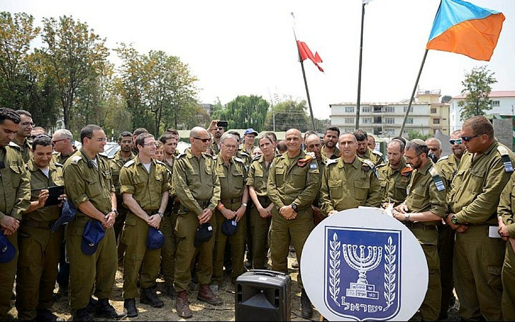Israeli soldiers in Nepal seen as they receive a phone call from President Reuven Rivlin, on May 07, 2015. (Photo credit: IDF Spokesperson)