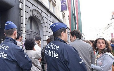 Police protecting participants at a silent vigil on May 25, 2014 outside Brussels' Jewish museum. (Cnaan Liphshiz/JTA)