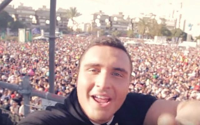 """Nadav Guedj performs Israel's Eurovision entry, """"Golden Boy,"""" in the song's official video. (Screen capture: YouTube)"""