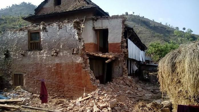 A house in Nepal partially destroyed following a devastating earthquake (photo credit: Tevel b'Tzedek)
